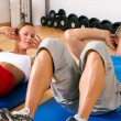 Sportive couple doing sit-ups — Stock Photo