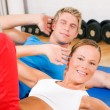Sportive couple doing sit-ups - Foto Stock