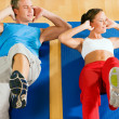 Sportive couple doing sit-ups — Stock Photo #5050760