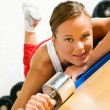 Beautiful young woman in a gym — Stock Photo