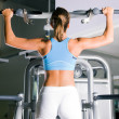 Beautiful woman doing pull-ups - Stockfoto