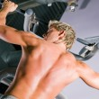 Strong man doing pull-ups on a - Stockfoto