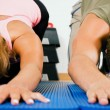 Couple doing push-ups and — Stock Photo