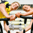 Couple exercising by spinning — Stock Photo