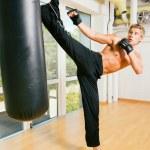 Kickboxer kicking — Stock Photo #5050888
