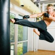 Kickboxer kicking - Stock Photo