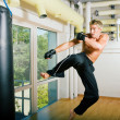 Kickboxer kicking — Stock Photo #5050895