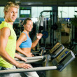 Couple in a gym working out on — Stock Photo
