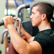 Stock Photo: Man doing fitness training on a
