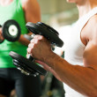 Strong man exercising with — Stock Photo