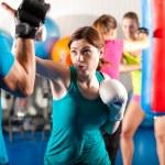 Woman Kick boxer kicking her — Stock Photo