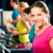 Running on treadmill in gym - Foto Stock