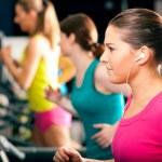 Running on treadmill in gym — Stock Photo
