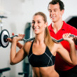 Woman in gym with personal — Foto de Stock