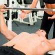 Man in gym with personal — Stock Photo #5051107