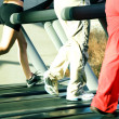 Three on the treadmill — Stock Photo #5051206