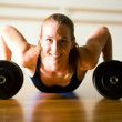 Powerful lady doing push-ups — Stock Photo