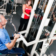 Senior in a gym - Stock Photo
