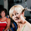 Senior in a gym - Foto Stock