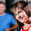 Mature woman in the gym lifting — Stock Photo #5051271