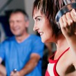 Mature woman in the gym lifting — Stock Photo #5051272