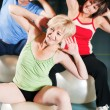 Senior woman in a gym  — Stockfoto