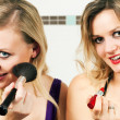 Stock Photo: Two female friends applying