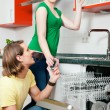 Couple cleaning their dishes in — Stock Photo