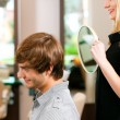 Man at the hairdresser, she has — Stock Photo #5051544