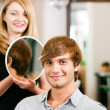 Man at the hairdresser, she has - Stock Photo