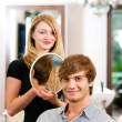 Royalty-Free Stock Photo: Man at the hairdresser, she has