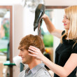 Man at the hairdresser, she has — Stock Photo #5051550
