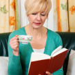 Mature woman is reading a — Stock Photo