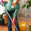 Royalty-Free Stock Photo: Woman cleaning and mopping
