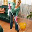 Woman cleaning and mopping  — Stock Photo