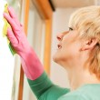 Mature woman cleaning her — Stock Photo