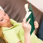 Woman having fun reading a — Stock Photo #5051655