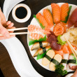 Couple eating sushi for dinner — Stock Photo #5051696