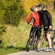 Sportive couple on bicycles — Stock Photo