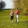 Athletic young couple jogging — Stock Photo #5051729