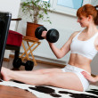 Woman is exercising with - Photo