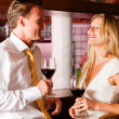 Man and woman in a hotel bar — Stock Photo