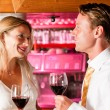 Stock Photo: Man and woman in a hotel bar