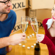 Young couple moving in new - Stock Photo