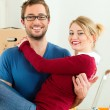 Young couple moving in new — Stock Photo #5052140