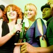 Stock Photo: Having a karaoke party