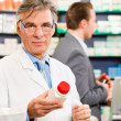 Stock Photo: Pharmacist with customers in