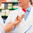 Pharmacist with customer in — Stock Photo #5052250