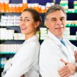 Royalty-Free Stock Photo: Pharmacist with customers in