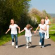 Royalty-Free Stock Photo: Kids running down a path in
